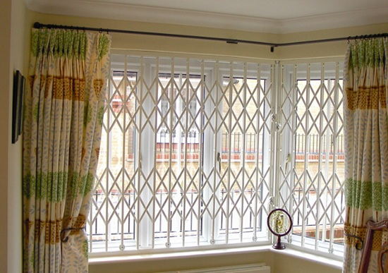 RSG retractable security grilles installed within a bay window