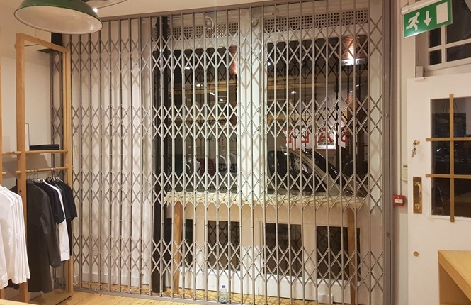 RSG1000 security grilles providing security to Sunspel shopping outlet in London City.