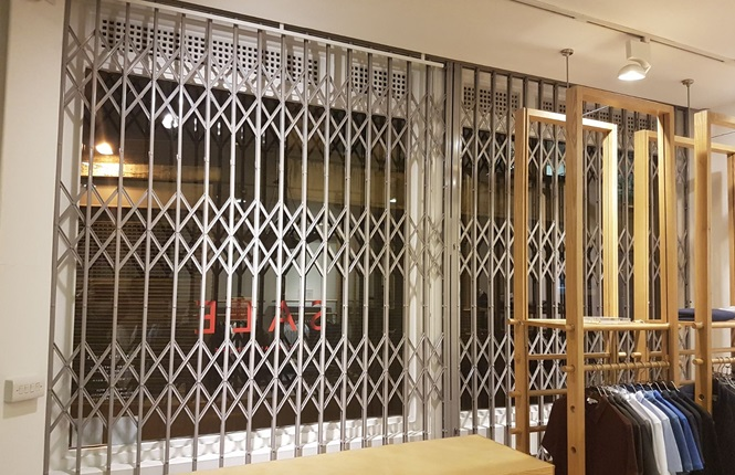 RSG1000 security grilles securing a clothing shop in Redchurch St, Central London.