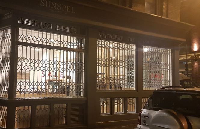 RSG1000 retractable grilles securing Sunspel shopping outlet in London City.
