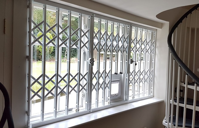 RSG1000 retractable window security grilles fitted to a house in Ilford..