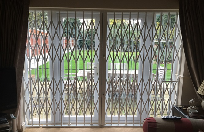 RSG1000 retractable grille fitted to the patio door of a residential property in Romford.
