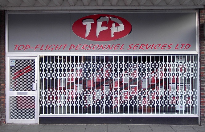 RSG1000 retractable security grilles securing a commercial retail outlet in West Essex.