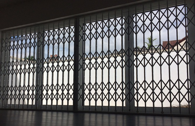RSG1000 retractble grilles fitted on a large patio door of a residential flat in Northwood, Greater London.