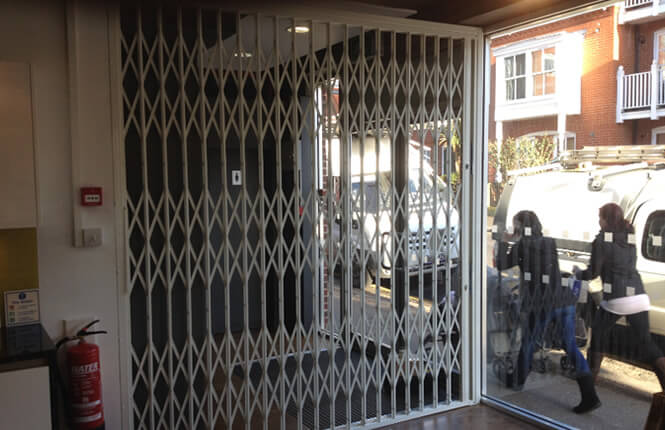 RSG1000 retractable security grille securing shop front in London West-End.