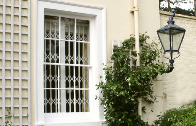 RSG1200 LPS1175 collapsible window grille on home in South London.