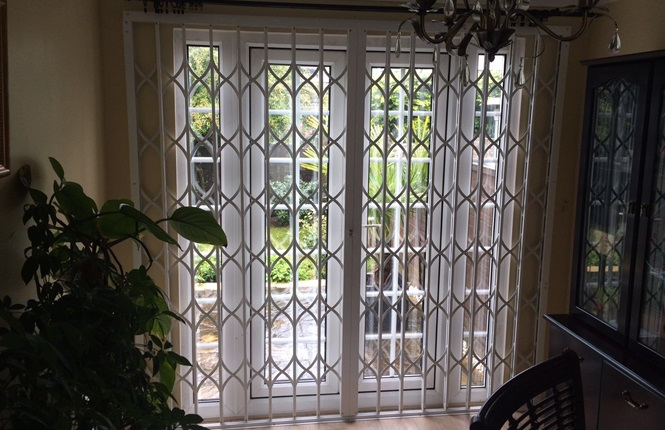RSG1200 LPS1175 SR1 collapsible patio door grille fitted to a residence in Harlow.