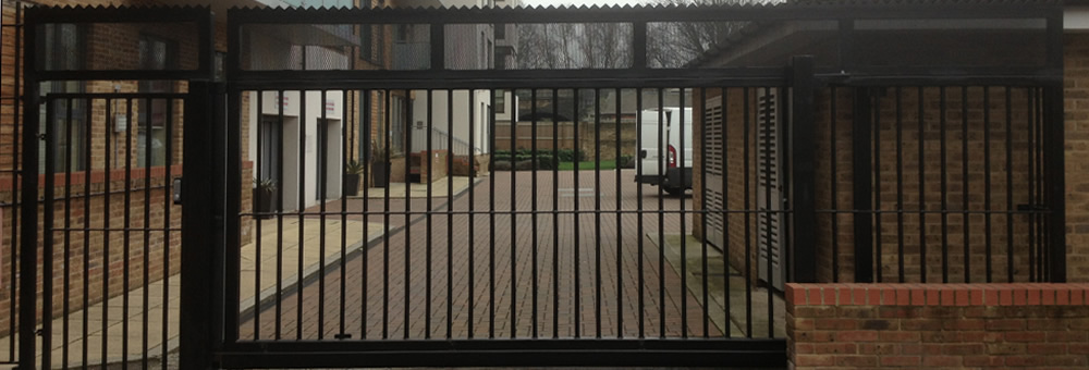 RSG3600 sliding and hinged gates on communal carpark in Wimbledon