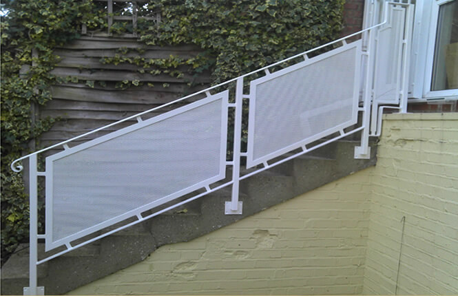 Stylish RSG4400 railings on domestic stairs in Wimbledon.