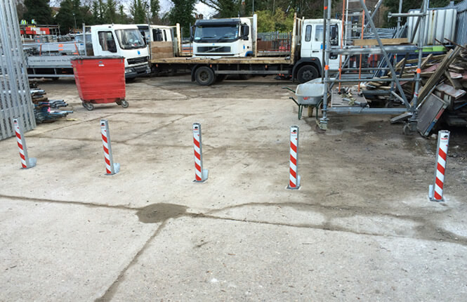 RSG4600 bollards restricting access on industrial warehouse in Mitcham.