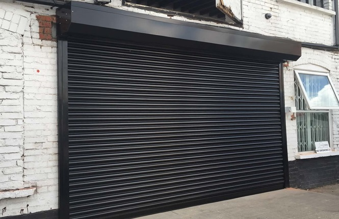 RSG5000 powder coated steel shutter fitted on commercial unit in North West London.