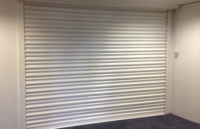 RSG5000 security shutter fitted internally in a commercial outlet in Islington.