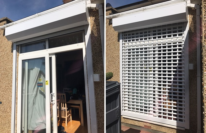 RSG5100 domestic shutter with punched lath and powder coated white fitted on a patio door at rear of a property.