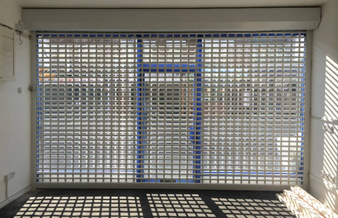 RSG5600 shop front roller shutter installed on a new shop in Hackney.