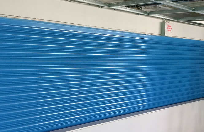 RSG5700 4Hour fire rated roller shutter fitted in the kitchen area of Hampton Junior School.