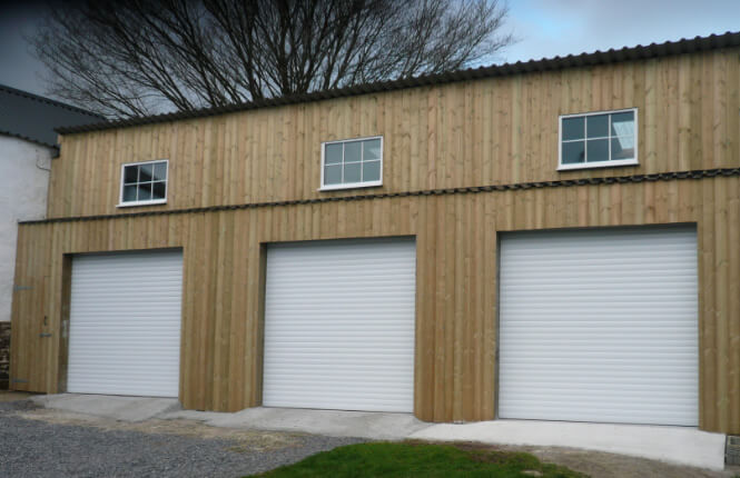 RSG7000 insulated roller doors on three garages in Middlesex.