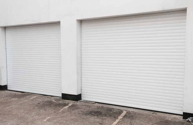 RSG7000 electrically operated security roller garage doors installed on a mechanic workshop in Sutton.