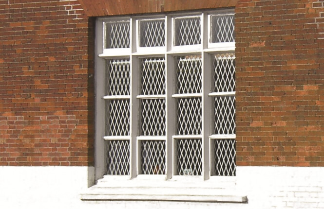 RSG800 fixed mesh grilles on residential window in Hackney.