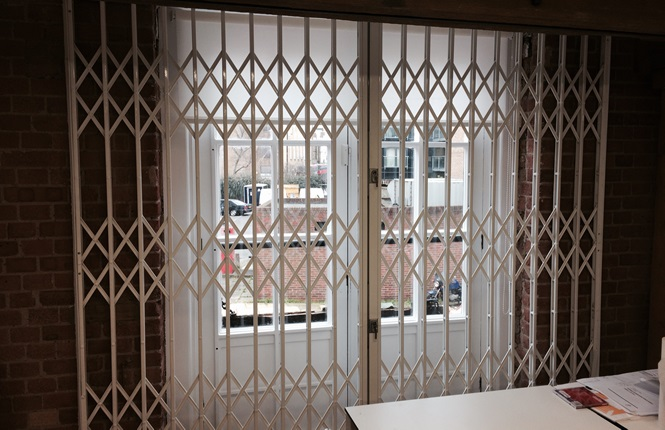 RSG1000 retractable patio door grilles providing security to an office in London.