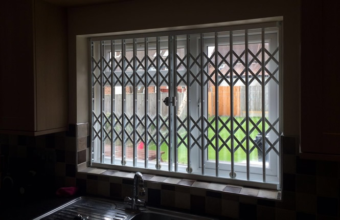 RSG1000 retractable grille securing the kitchen window of a house in Harlow.