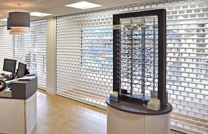 RSG5600 shop front roller shutters securing Raylings Opticians in Eastleigh.